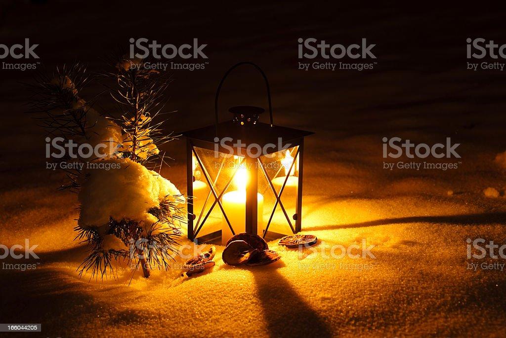 Lantern in snow stock photo