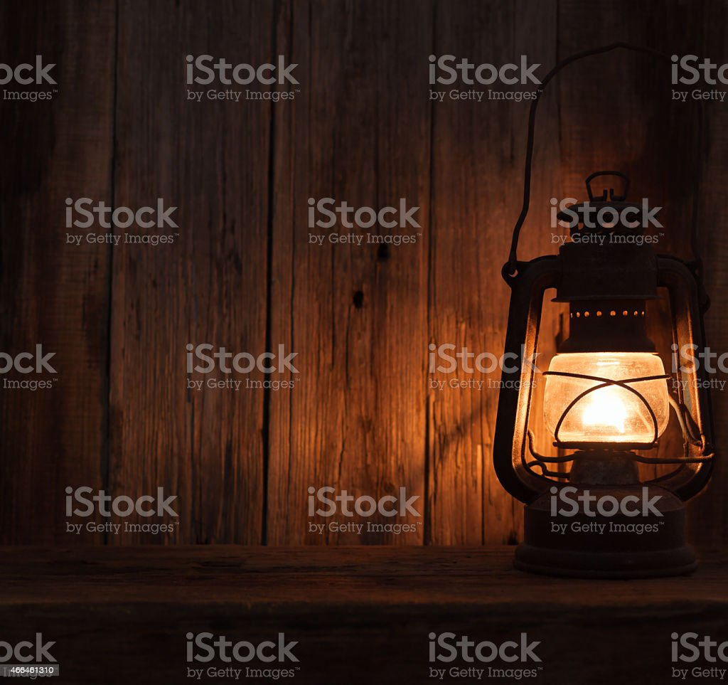 lantern lamp light dark wooden wall table background stock photo
