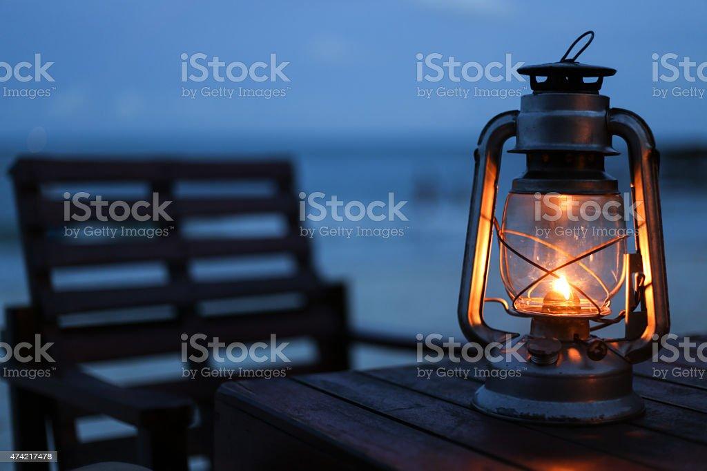 Lantern on the beach stock photo