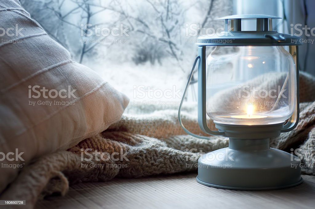 lantern on windowsill stock photo