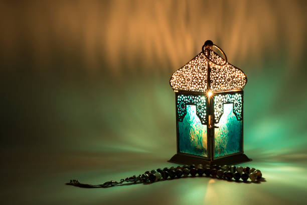 lantern reflects a special colored lights - eid stock pictures, royalty-free photos & images