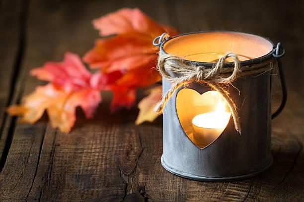 lantern with autumn leaves - herbst kerzen stock-fotos und bilder
