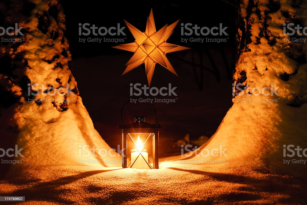 Lantern with candle and light star. stock photo