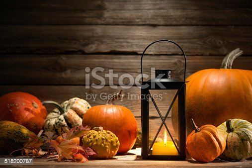 istock Lantern with candle and  pumpkins 518200767