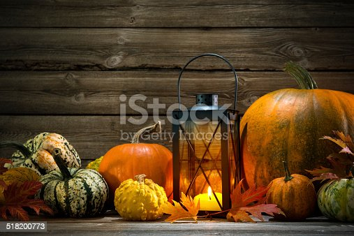 istock Lantern with candle and  pumpkins 518200773