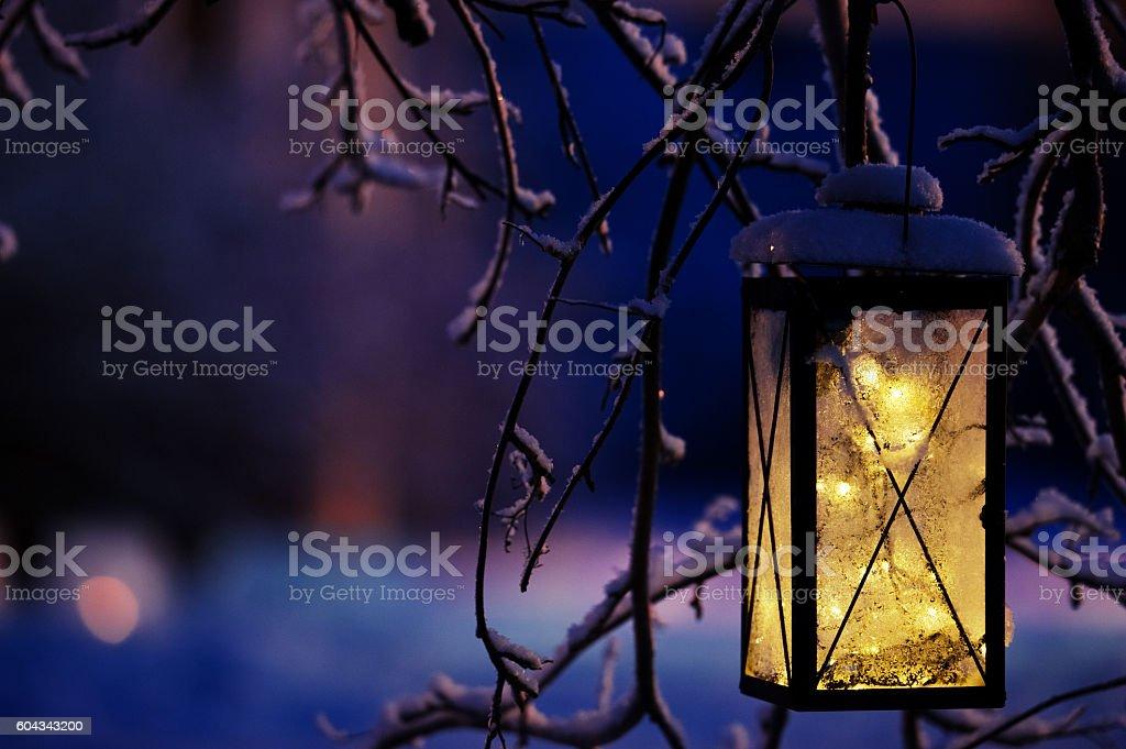Lantern with Christmas lights stock photo