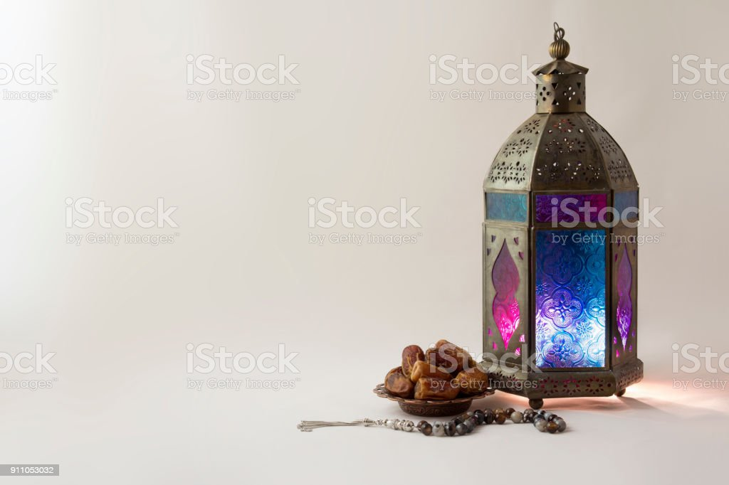 Lantern with dates fruits and rosary beads stock photo