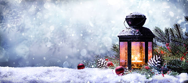 lantern with fir branches on snow - christmas stock photos and pictures