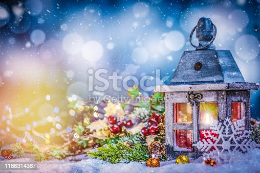 istock Lantern with Lit Candle and Christmas Decorations with Copy Space 1186314367