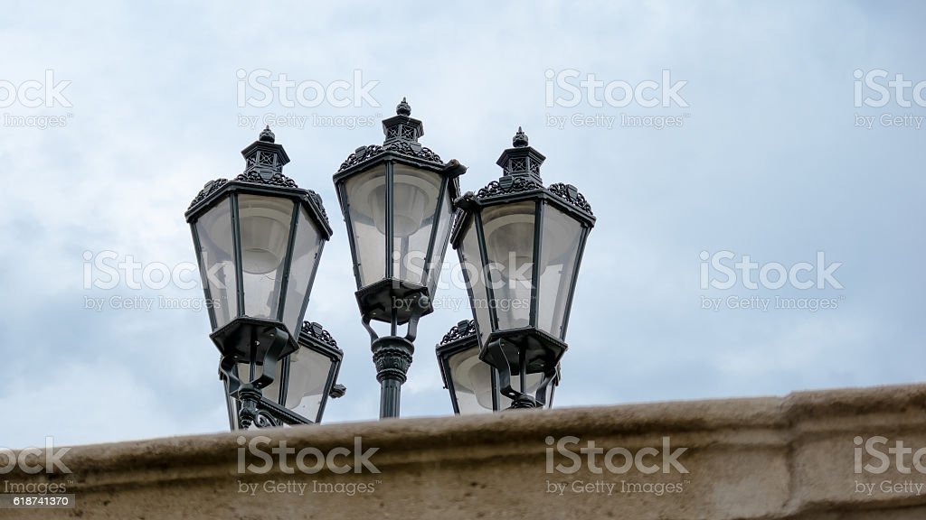 Lanterns behind the wall stock photo
