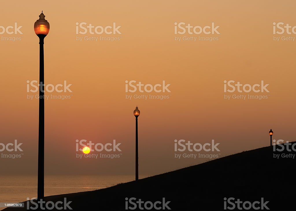 Lanterns by Water at Sunrise stock photo