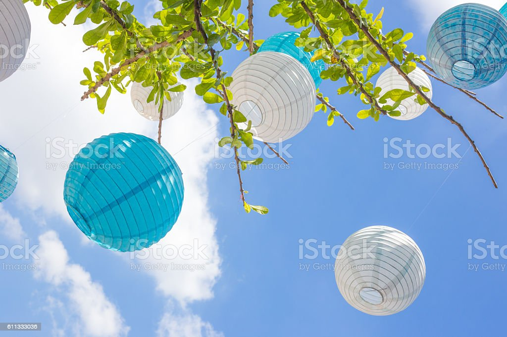 Lanterns in blue and white on a sunny day stock photo