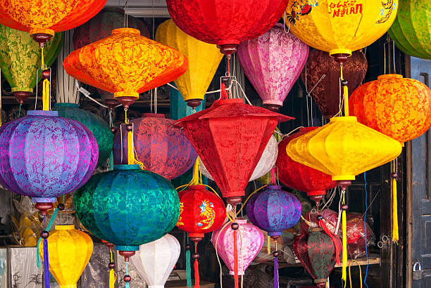 Lanterns on Hoi An A market stall in Hoi An, Vietnam sells brightly colored lanterns. asian market stock pictures, royalty-free photos & images
