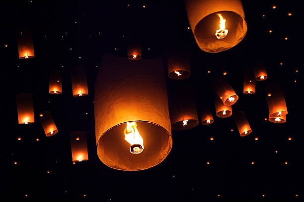 lanterns to the sky in loy kratong festival - kratong stock photos and pictures