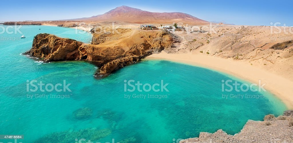 Lanzarote Papagayo turquoise beach and Ajaches stock photo