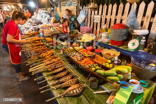 istock Lao food sold from stalls at the food market in Luang Prabang Laos. 1204902176