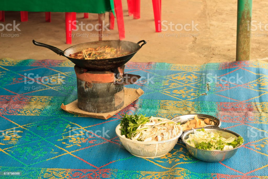 Lao food with chicken feet prepared in a big pan stock photo
