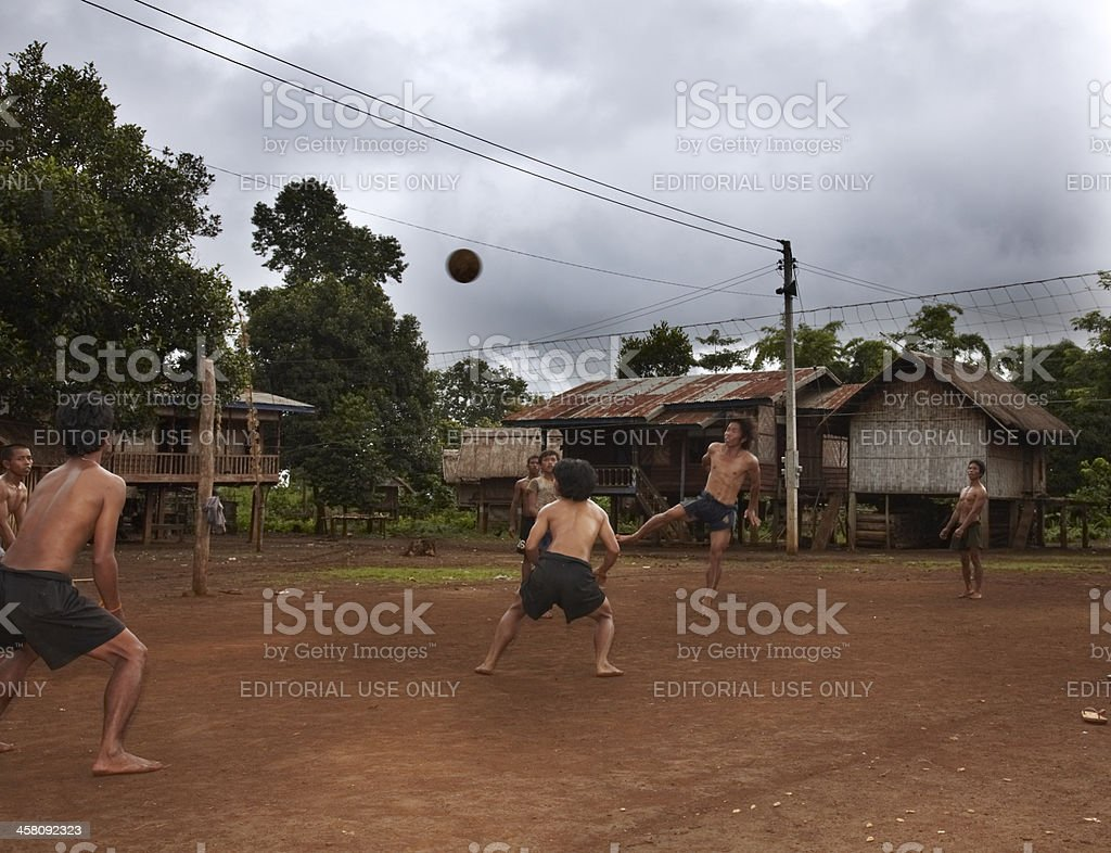 Lao youth playing sports royalty-free stock photo