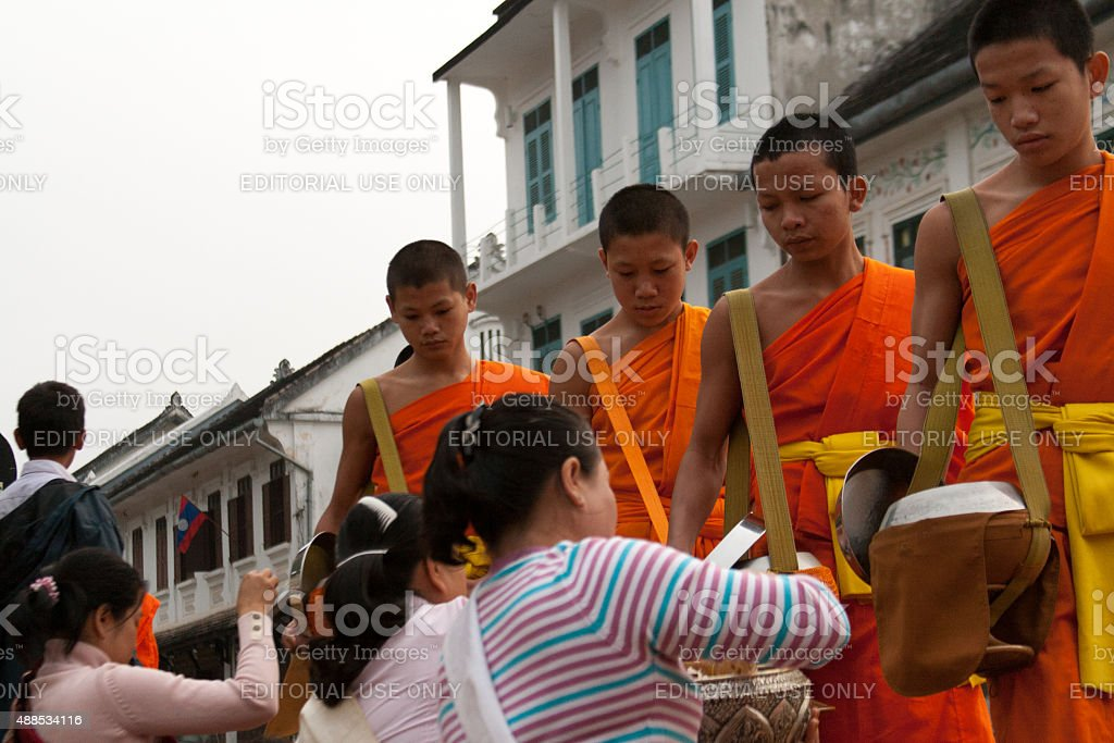 Laos: Monks Begging For Alms at Dawn in Luang Prabang stock photo