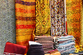 background with colored textiles, materials in tissue tailors many colors at morning market in Vientiane, Laos