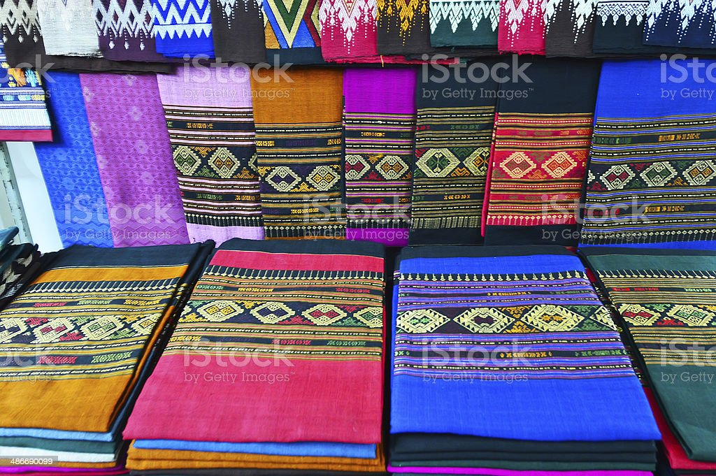 background with colored textiles, materials in tissue tailors many...