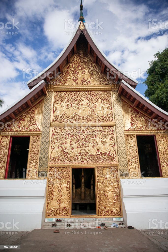Laos style art at wall in Wat Xieng Thong temple, The most important buddhist temple in Luang Prabang, Laos. stock photo