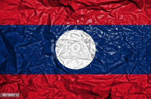 Laos vintage flag on old crumpled paper background