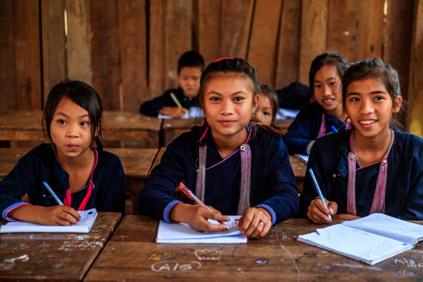 Laotian children in a primary school, village in Northern Laos Laotian children, wearing traditional Lantan tribe clothes, during classes in a primary school in Lantan village in Northern Laos developing countries stock pictures, royalty-free photos & images
