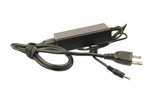 istock Laptop AC adapter isolated on white background 669971286