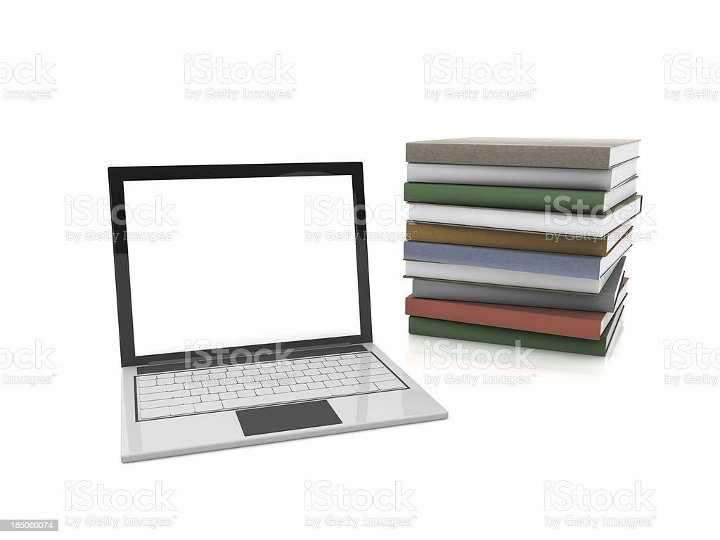 Notebook e livros - foto de acervo