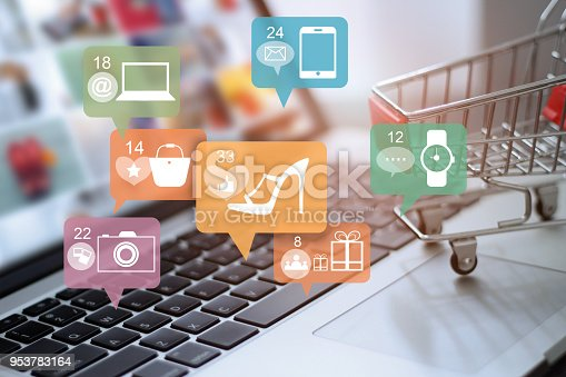 Laptop and cart with icon online shopping and social media networking. Online marketing and payment concept.
