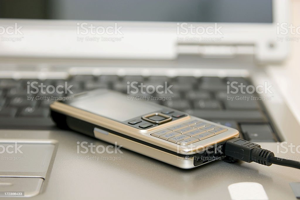 laptop and cell phone royalty-free stock photo