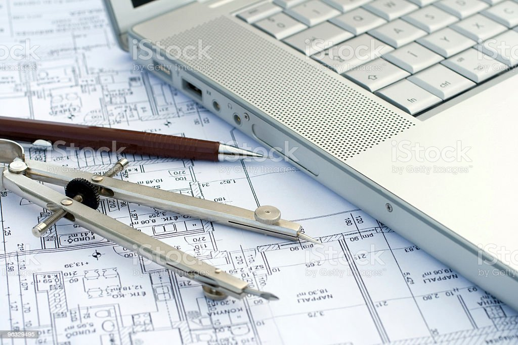Laptop and compass on a blueprint royalty-free stock photo