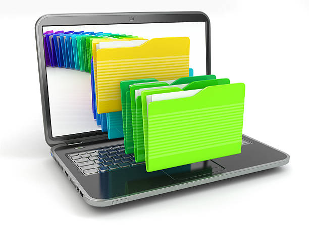 Laptop and computer files  in  folders. stock photo