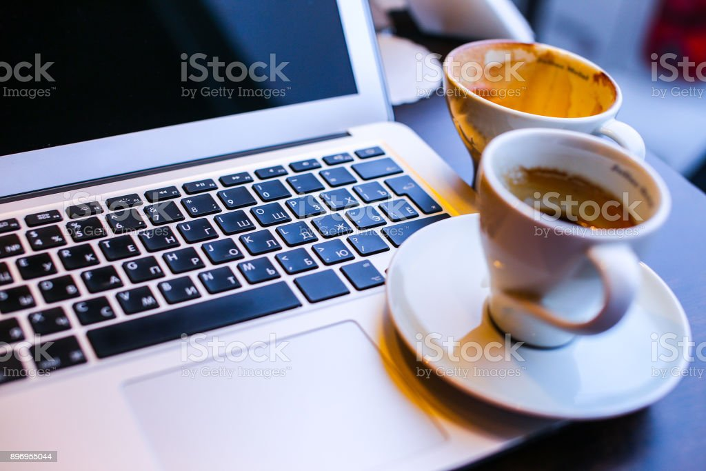 Laptop and cup of coffe stock photo