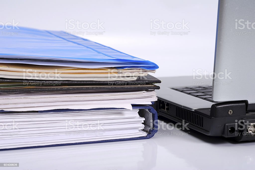 Laptop and documents royalty-free stock photo