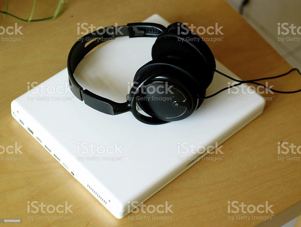 Laptop and earphone royalty-free stock photo