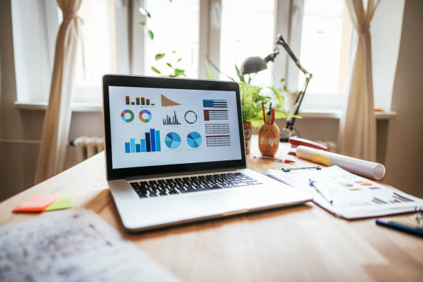 Laptop and financial business at home - copy space on the photo stock photo