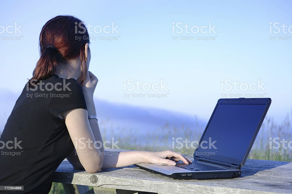 Laptop and girl outdoors royalty-free stock photo