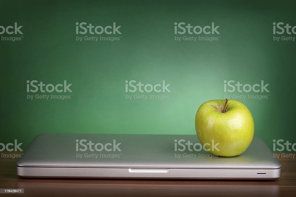 Laptop and green apple stock photo