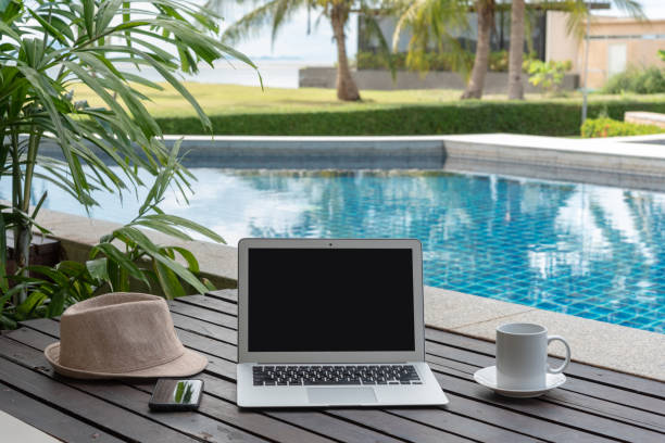 laptop and hat at the pool. stock photo