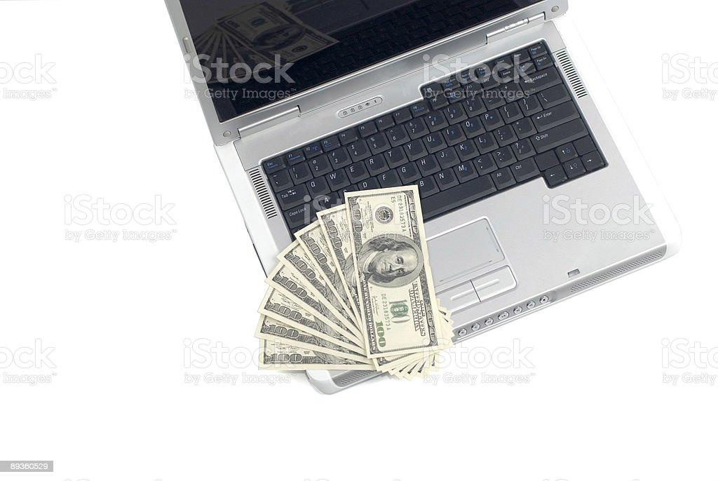 Laptop and Money royalty free stockfoto
