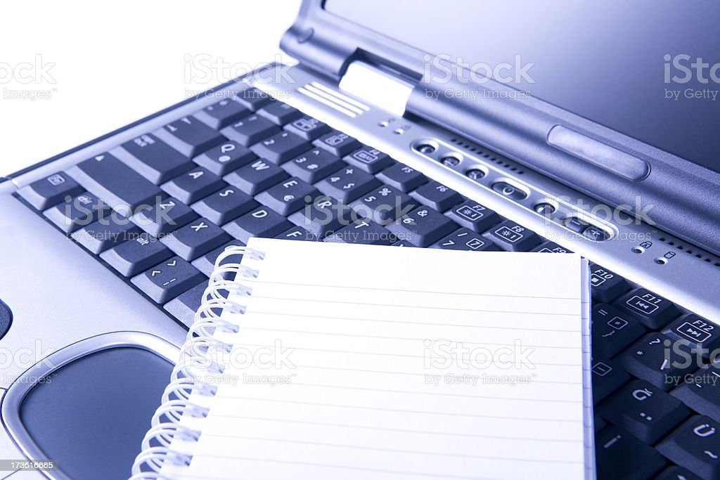 laptop and notepad royalty-free stock photo