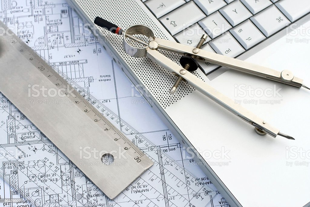 Laptop and rulers on a blueprint royalty-free stock photo