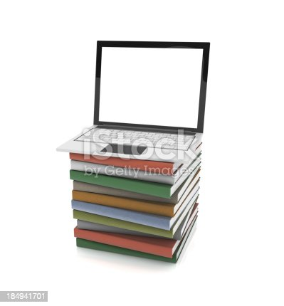 istock Laptop and Stack of Books 184941701