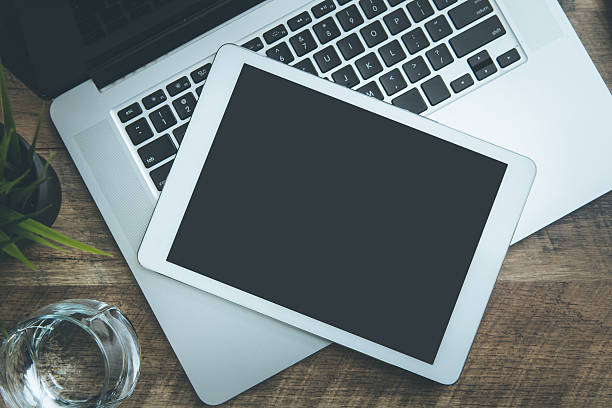 Laptop and Tablet Pc on Business Desk - foto de acervo