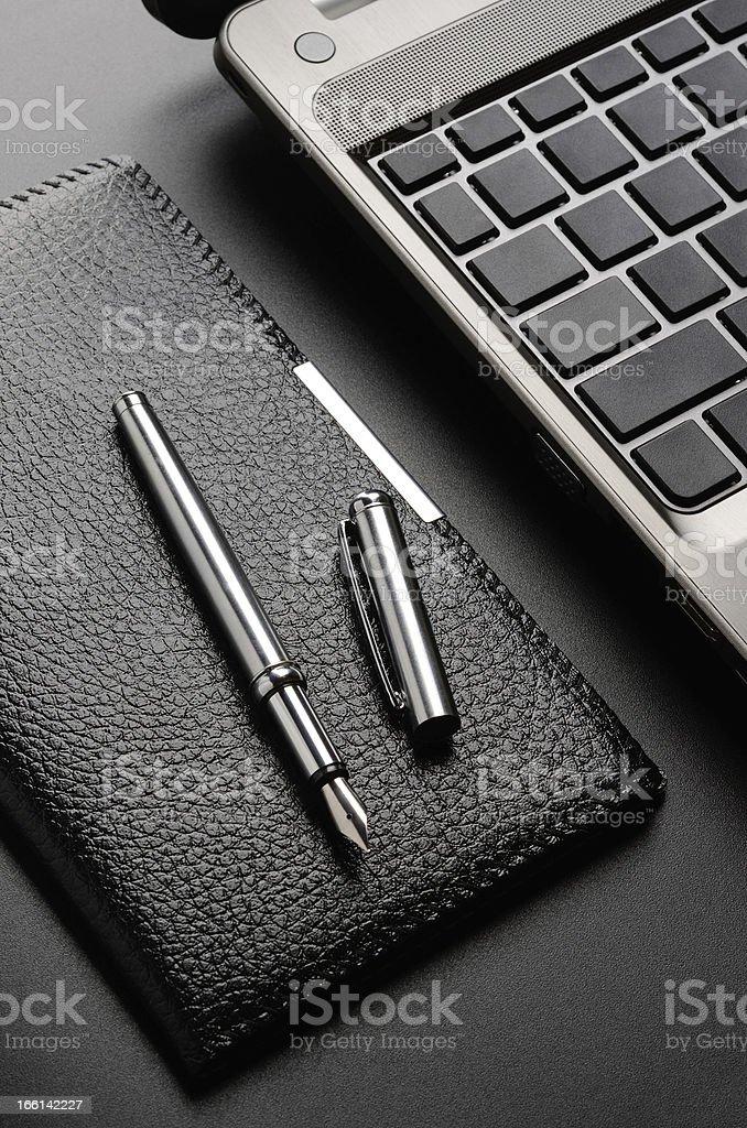 Laptop, card holder, fountain pen royalty-free stock photo