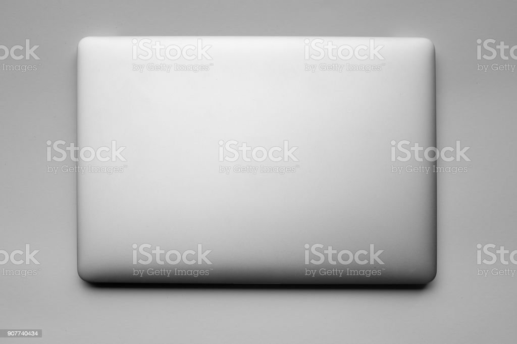 Laptop closed from above stock photo
