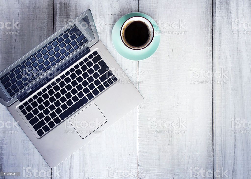 Laptop coffee cup work place on wooden background empty space. stock photo