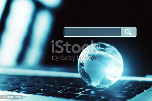 istock Laptop  computer and world  with internet network structure. Searching information data on internet networking concept 1079980730